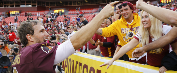 Washington Redskins quarterback Kirk Cousins (8) points towards the fans after an NFL football game against the Tampa Bay Buccaneers in Landover, Md., Sunday, Oct. 25, 2015. The Washington Redskins defeated the Tampa Bay Buccaneers 31-30. (AP Photo/Patrick Semansky)