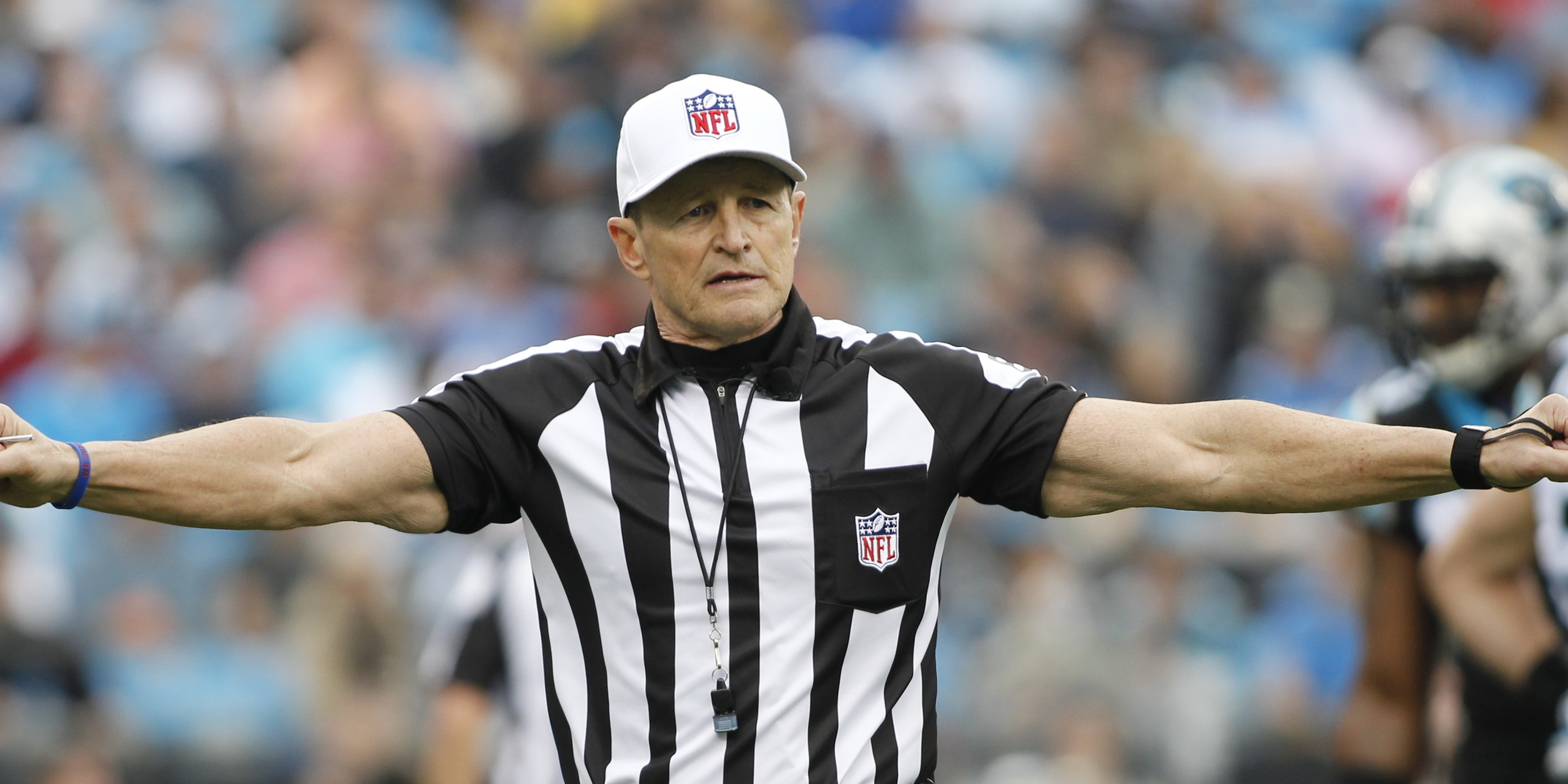 Referee Ed Hochuli makes a call during the first half of an NFL football game between the Carolina Panthers and the Atlanta Falcons in Charlotte, N.C., Sunday, Dec. 9, 2012. (AP Photo/Bob Leverone)